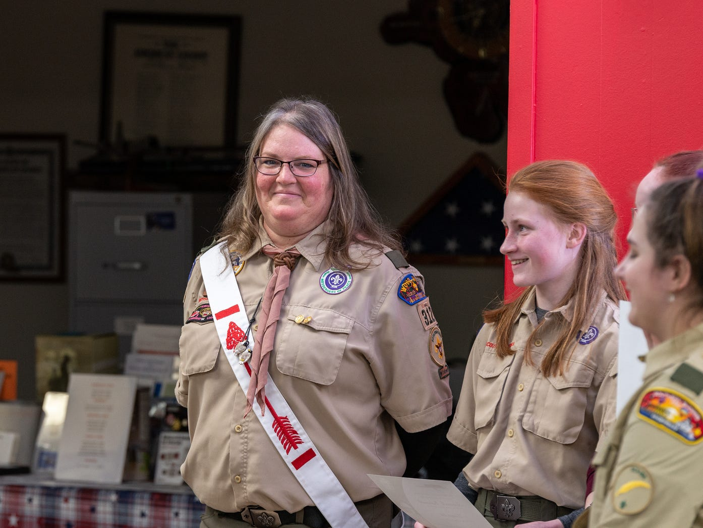 Heather Hudson, the new Troop 310 Scout Master smiles during the inauguration ceremony Monday Feb. 18, 2019.