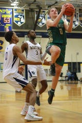Howell's Josh Palo drives to the basket to tie the game, 55-55, with 1:29 left in a 58-57 victory at Wayne Memorial on Monday, Feb. 18, 2019.