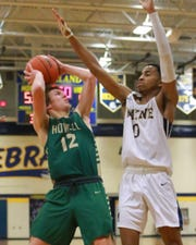 Howell's Tony Honkala puts up a shot over Wayne Memorial's Isaiah Lewis in the Highlanders' 58-57 victory on Monday, Feb. 18, 2019.