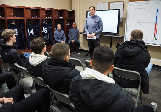 Lansing Ignite head coach Nate Miller meets his team on Monday, Feb. 19, 2019.