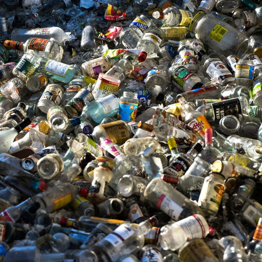 A pile of glass that will be recycled seen at a Granger Recycling Center on Wood Road in Lansing, pictured Feb. 19, 2019.