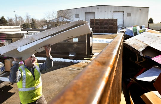 Pat McNamara of St. Johns recycles cardboard Tuesday, Feb. 19, 2019, at the Granger Recycling Center in Lansing.