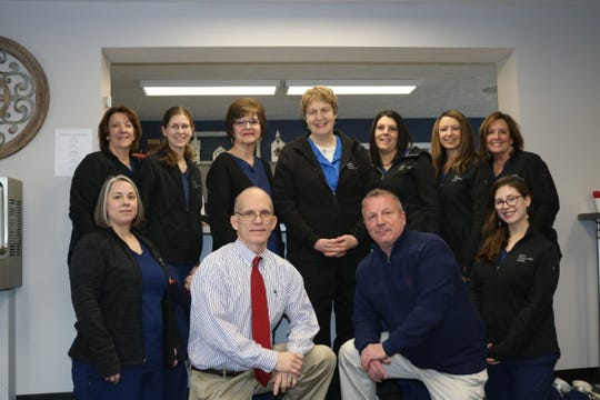 Staff at Delta Chiropractic Center pose for a photo at its new location, 6130 W. Saginaw Highway in Delta Township. The center's previous building was destroyed in a fire last July. Pictured (back row, from left) is Jackie Hudson, Elizabeth Hugo, Susan Gamel, Ruth Ray, Tracy Gollehon, Tammie Mills, Shawna Shaw, (front row, from left) Dawn Richards, Dr. Charles Roost, Dr. Daniel Dail and Jessica Alberici.
