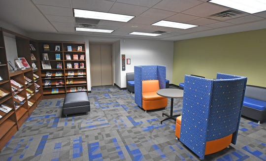 The remodeled lobby of the Mansfield/Richland County Public Library include new displays and furniture suited for reading and charging electronic devices.