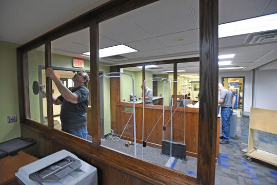 Workers hurry to finish the upgrades to the Mansfield/Richland County Library on Tuesday afternoon. The library opens back up Wednesday morning.