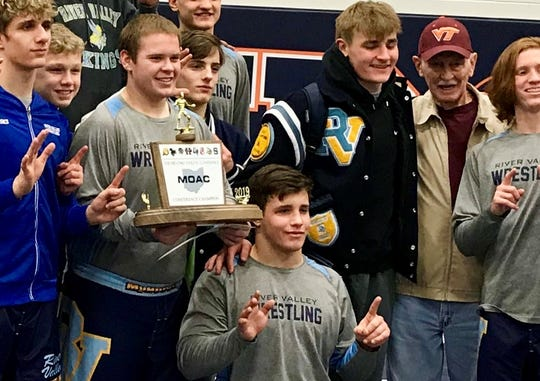 River Valley senior Mitchell Miracle, kneeling, poses with his teammates after the Vikings won their sixth straight MOAC Wrestling Tournament. Miracle returned from ma broken hand recently and won the 195 title at the MOAC meet.