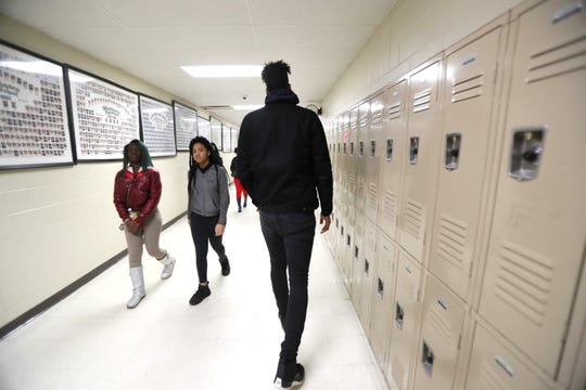 """Jordan Wilmore, who at 7'2"""" towers above his fellow classmates, walks the halls to class at Whitehaven High School on Tuesday, Feb. 19, 2019."""