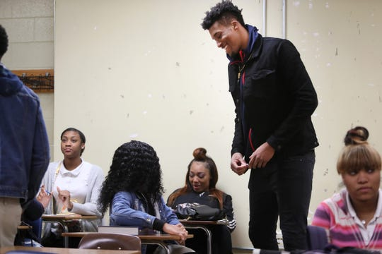 Jordan Wilmore chats with classmates during his applied math concepts course at Whitehaven High School on Tuesday, Feb. 19, 2019.