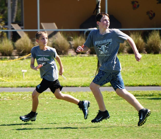 Nathan Olsen and Grayson Jones going out for a pass.