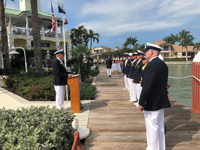 Marco Island Yacht Club Commodore Jeff Comeaux, left, addresses bridge officers at the start of the annual bessing of the feet ceremony held Feb. 16.