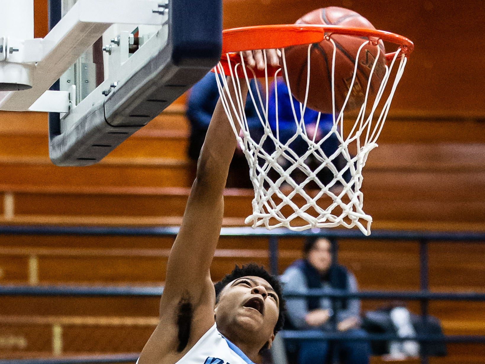 Nicolet's CJ Hayes (24) dunks one at home against Whitefish Bay on Monday, Feb. 18, 2019.