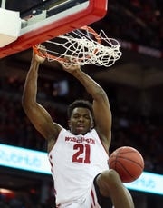 Feb 18, 2019; Madison, WI, USA; Wisconsin Badgers guard Khalil Iverson (21) dunks the ball during the game with the Illinois Fighting Illini at the Kohl Center. Mandatory Credit: Mary Langenfeld-USA TODAY Sports
