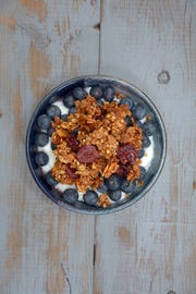 This fruit and yogurt parfait features granola made with oats and buckwheat.