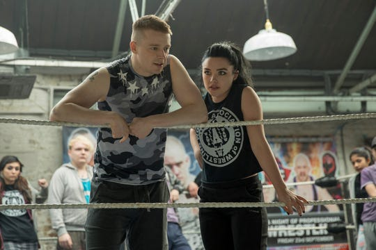 "Jack Lowden (left) and Florence Pugh play siblings trying to find their place in the world of professional wrestling in ""Fighting With My Family."""