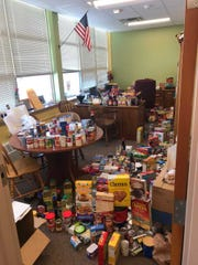Riverside Elementary School principal Scott Walter's office is filled with food donations for the Menomonee Falls Food Pantry.