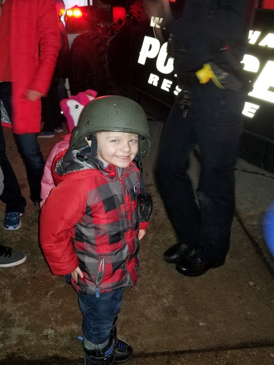 Emmit Olson was all smiles wearing a police department helmet during a combined birthday party with his older brother, Jordi, on Feb. 16. Two members of the Waukesha Police Department came over to celebrate their birthday.