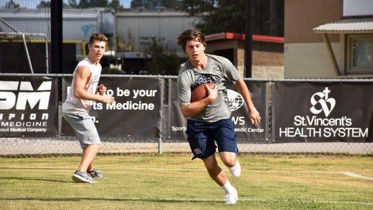 "Dave (Evan Hofer, left) and Zach Truett (Tanner Stine) run drills in ""Run the Race."""