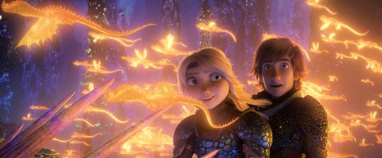 "Astrid (left, voiced by America Ferrera) and Hiccup (Jay Baruchel) marvel at a dragon sanctuary in ""How to Train Your Dragon: The Hidden World."""