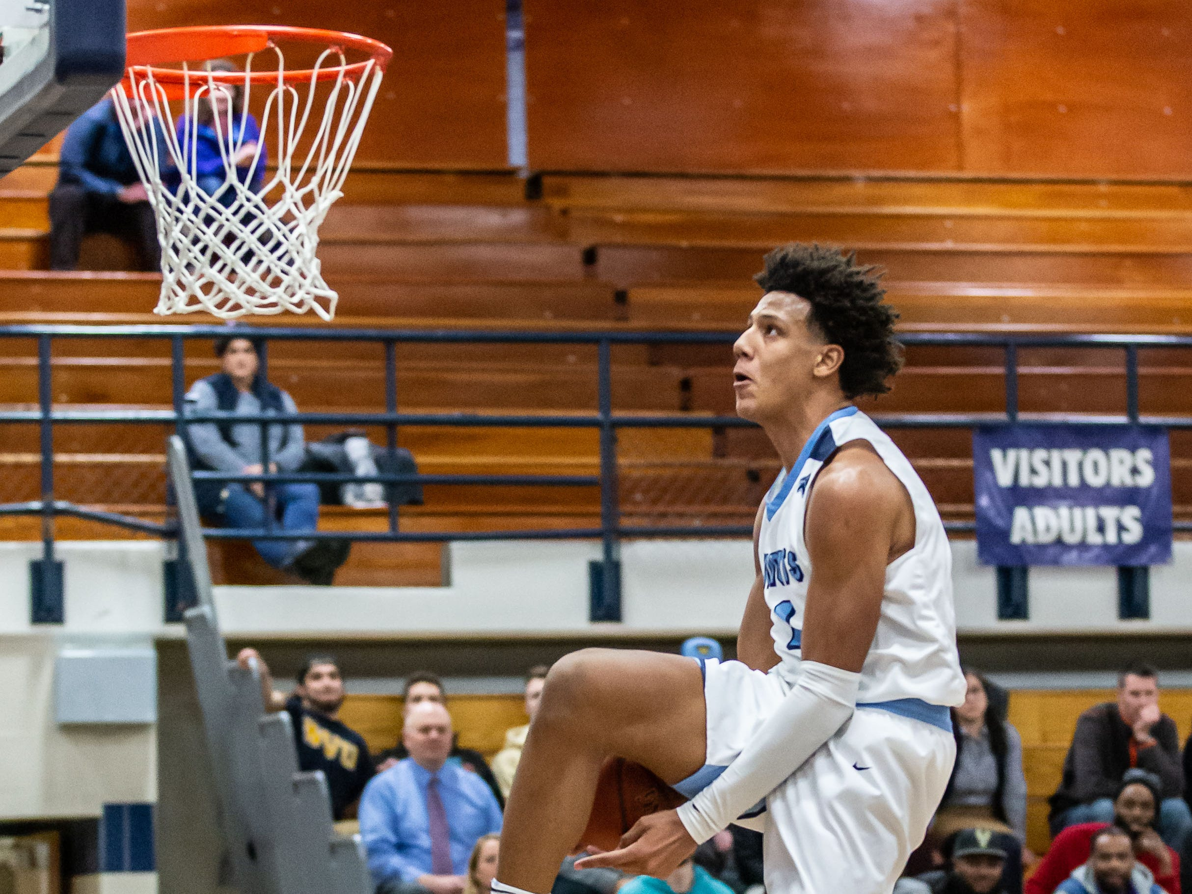 Nicolet's Jalen Johnson (1) eyes the hoop on a break-away dunk attempt at home against Whitefish Bay on Monday, Feb. 18, 2019.