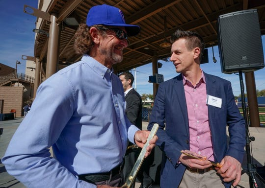 Milwaukee Brewers Hall of Famer Robin Yount (left) talks to manager Craig Counsel at a ribbon-cutting ceremony for the team's refurbished spring training baseball facility last week. Yount will be inducted Tuesday into the Cactus League Hall of Fame.