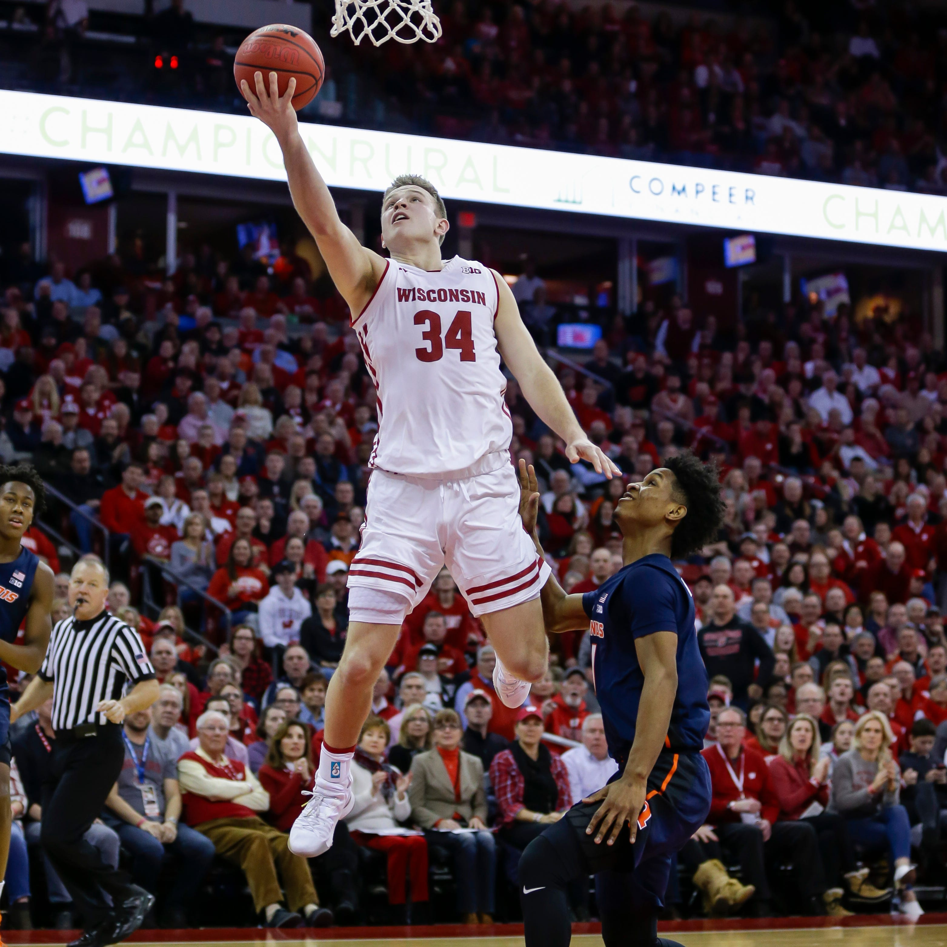Brad Davison goes in for a layup after beating...