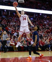 Brad Davison goes in for a layup after beating Illinois' defense down the court during the second half Monday night at the Kohl Center in Madison.