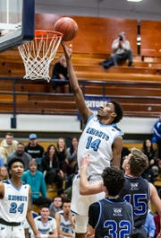 Nicolet's Jamari Sibley (14) lays one in during the game at home against Whitefish Bay on Monday, Feb. 18, 2019.