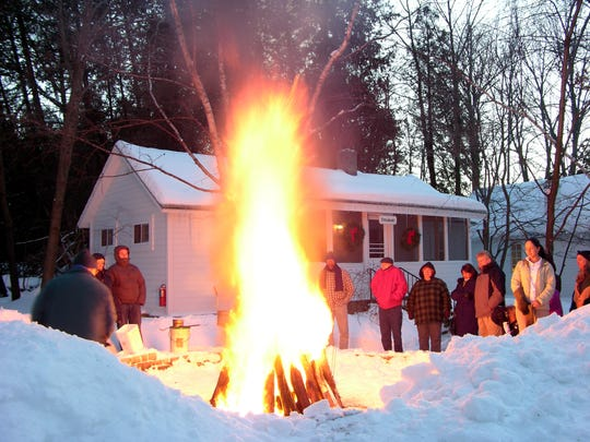 Visitors enjoy a traditional fish boil in the winter at Fish Creek's White Gull Inn.
