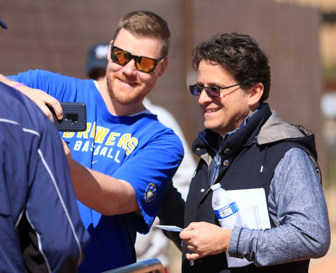 Milwaukee Brewers owner Mark Attanasio poses for a photo with Mike Geiger, formerly of Wausau, at American Family Fields of Phoenix, Tuesday.