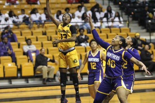 Grambling State senior guard Jazmin Boyd (13) puts up a floater against Prairie View A&M during a SWAC regular season game at the Fredrick Hobdy Arena Monday, Feb. 28, 2019.