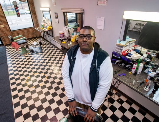 Justin Coleman in his barber shop, Trimmers, in Demopolis, Ala., on Tuesday February 19, 2019.