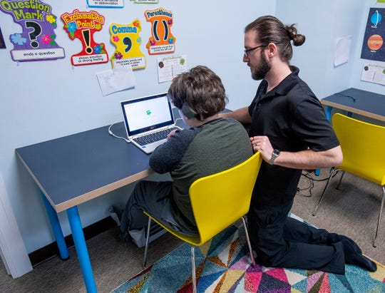 Teacher Steven Cook works with Cayde at The New School in Montgomery, Ala., on Tuesday February 19, 2019.