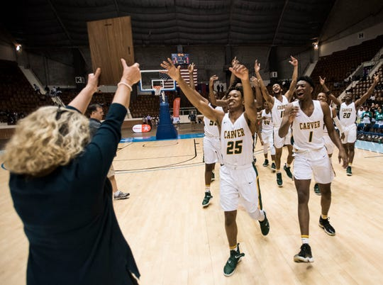 Carver players receive their plaque after winning the Class 6A southeast regional championship at Garrett Coliseum in Montgomery, Ala., on Tuesday, Feb. 19, 2019. Carver defeated Lanier 58-54.