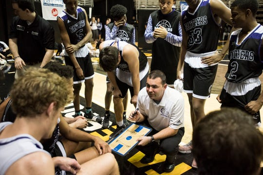 Prattville Christian coach Jason Roberson talks with his team during a timeout during the Class 3A regional semifinal at Dunn-Oliver Acadome in Montgomery, Ala., on Monday, Feb. 18, 2019. Prattville Christian defeated Mobile Christian 55-46.