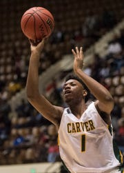 Carver's Jaykwon Walton (1) goes up for a layup during the Class 6A southeast regional championship at Garrett Coliseum in Montgomery, Ala., on Tuesday, Feb. 19, 2019. Carver leads Lanier 26-23 at halftime.