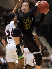 Carver's Kristin Brown (30) goes in for a layup during the Class 6A southeast regional championship at Garrett Coliseum in Montgomery, Ala., on Tuesday, Feb. 19, 2019. Opelika leads Carver 33-22.