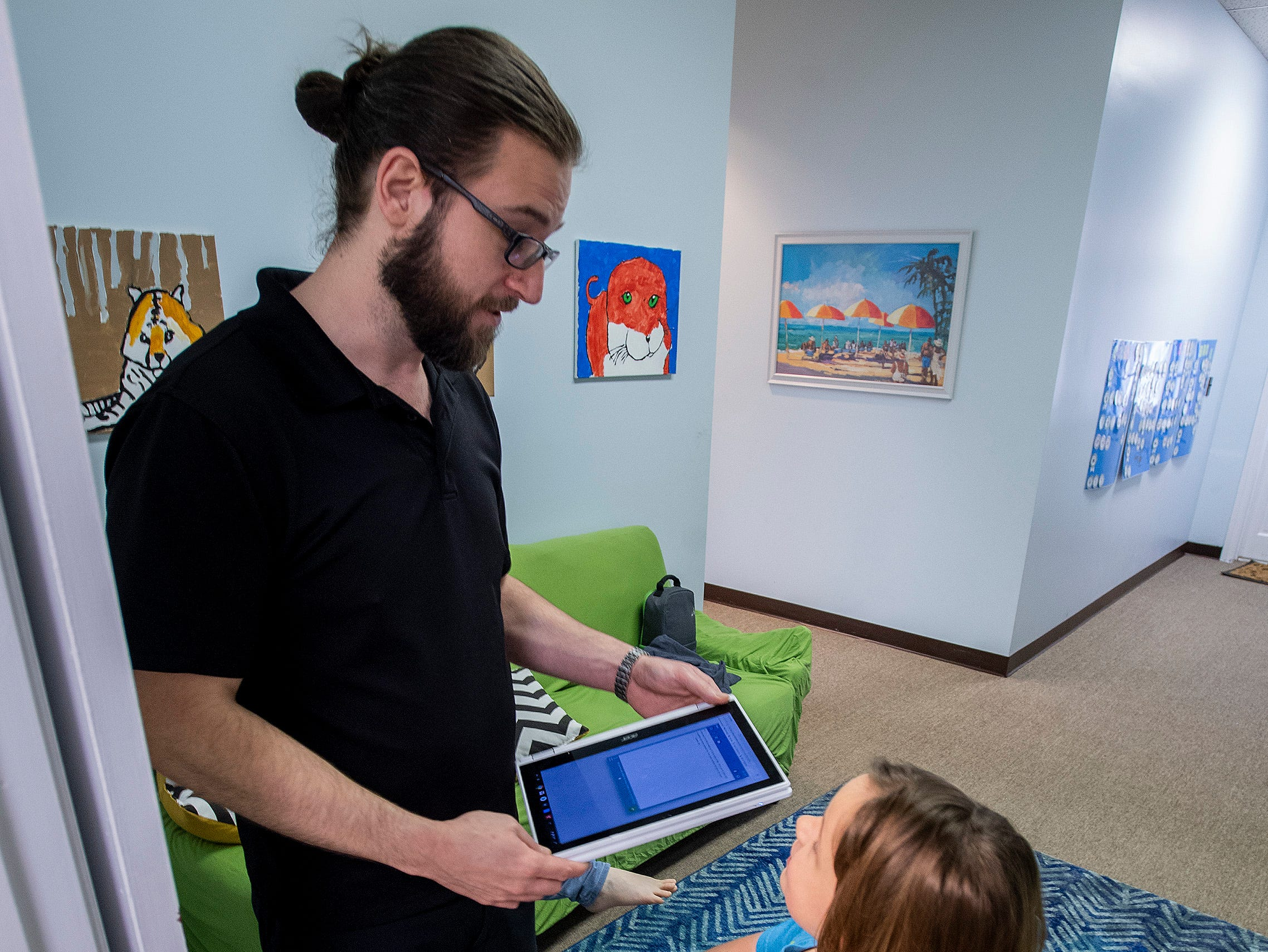 Teacher Steven Cook works with Lily at The New School in Montgomery, Ala., on Tuesday February 19, 2019.
