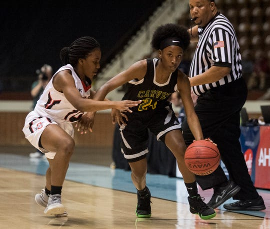 Carver's Trinity Thomas (24) takes the ball down the court during the Class 6A southeast regional championship at Garrett Coliseum in Montgomery, Ala., on Tuesday, Feb. 19, 2019. Opelika leads Carver 33-22.