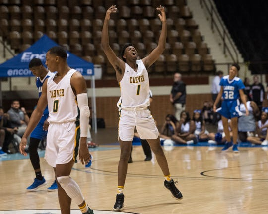 Carver's Jaykwon Walton (1) celebrates in the final minutes of the Class 6A southeast regional championship at Garrett Coliseum in Montgomery, Ala., on Tuesday, Feb. 19, 2019. Carver defeated Lanier 58-54.