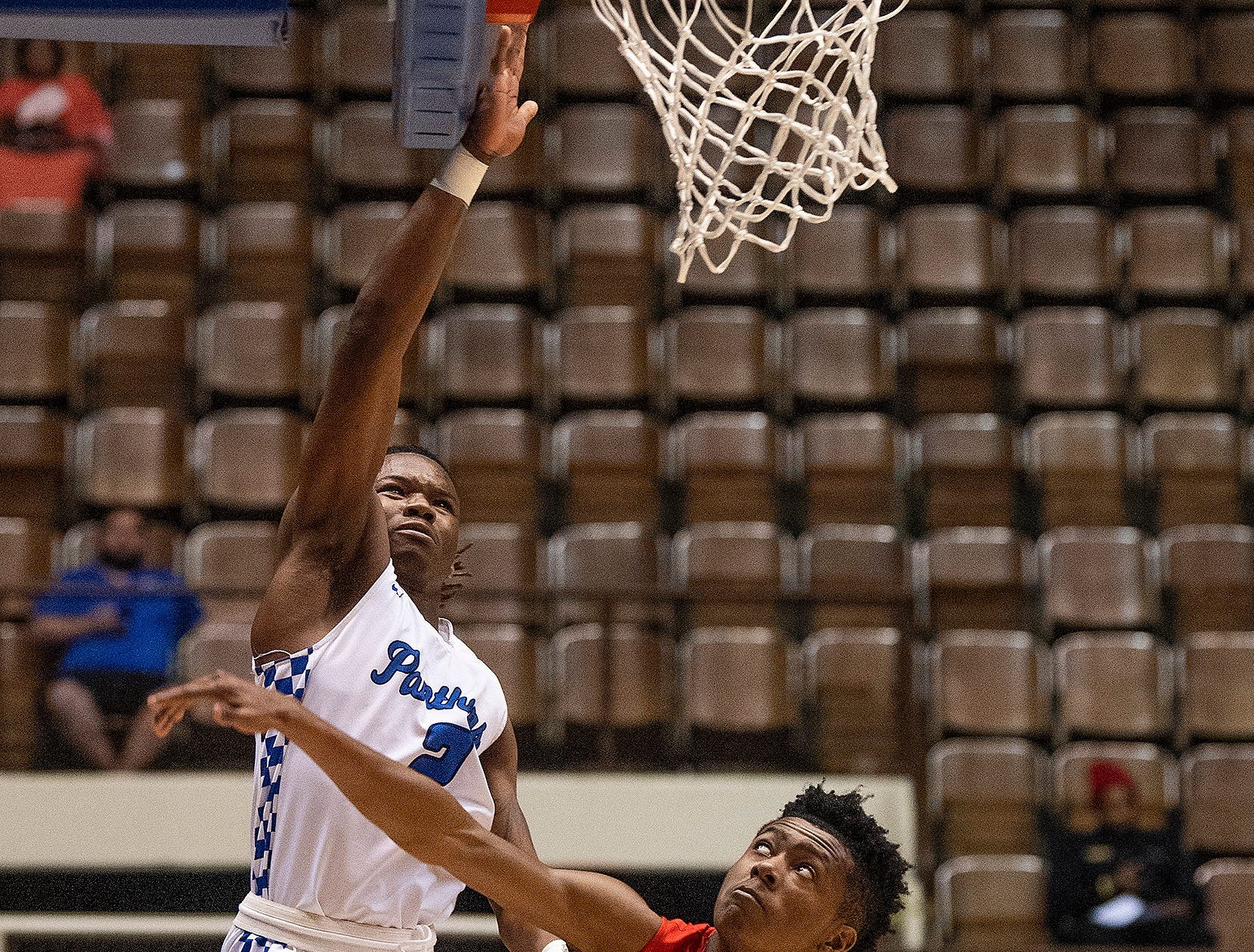 Georgiana's Christopher Mixon shoots over Cornerstone's Rhyan Burks in AHSAA Regional action at Garrett Coliseum in Montgomery, Ala., on Monday February 18, 2019.