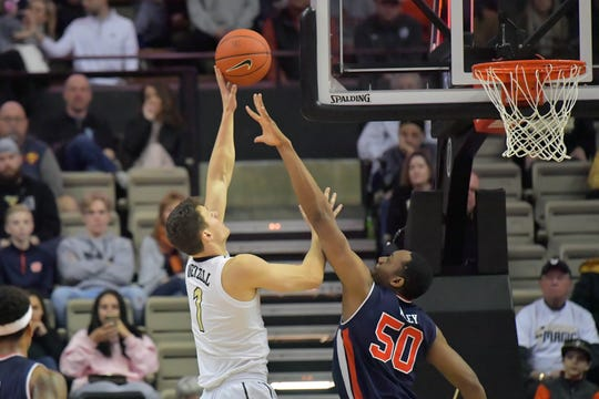 Auburn center Austin Wiley (50) defends the shot of Vanderbilt forward Yanni Wetzell (1) on Feb. 16, 2019, in Nashville, Tennessee.