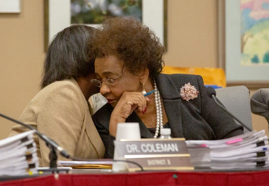 Montgomery Public Schools Board member Brenda DeRamus-Coleman talks with board member Mary Briers privately during a meeting.