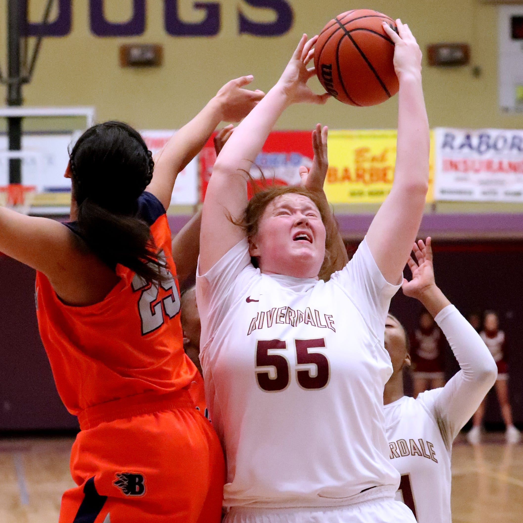 Riverdale's Katelyn Worely (55) and Blackman's Aaliyah Green (25) both go after a rebound during the District 7-AAA tournament championship game on Monday, Feb. 18, 2019.