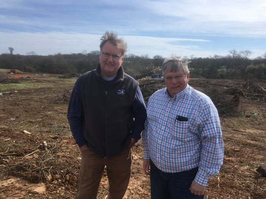 Murfreesboro City Councilman Eddie Smotherman, left, and Frank Caperton pose in the Gateway area that used to be part of the earth mounds for the Civil War-era Fortress Rosecrans. The Gateway land will be developed for residential and commercial uses on the south side of Medical Center Parkway and west side of the city's Fire Station 4 property.