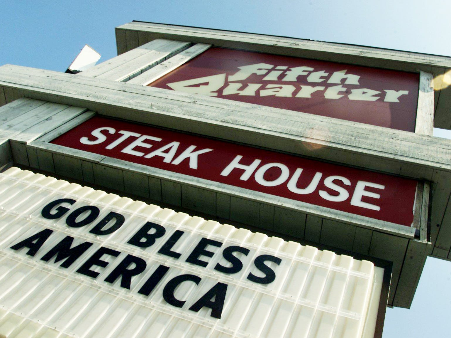 """A sign at the Fifth Quarter Steak House reads """"God Bless America"""" Sept. 12, 2001, a popular slogan for numerous businesses along Murfreesboro Road after the World Trade Center aftermath."""