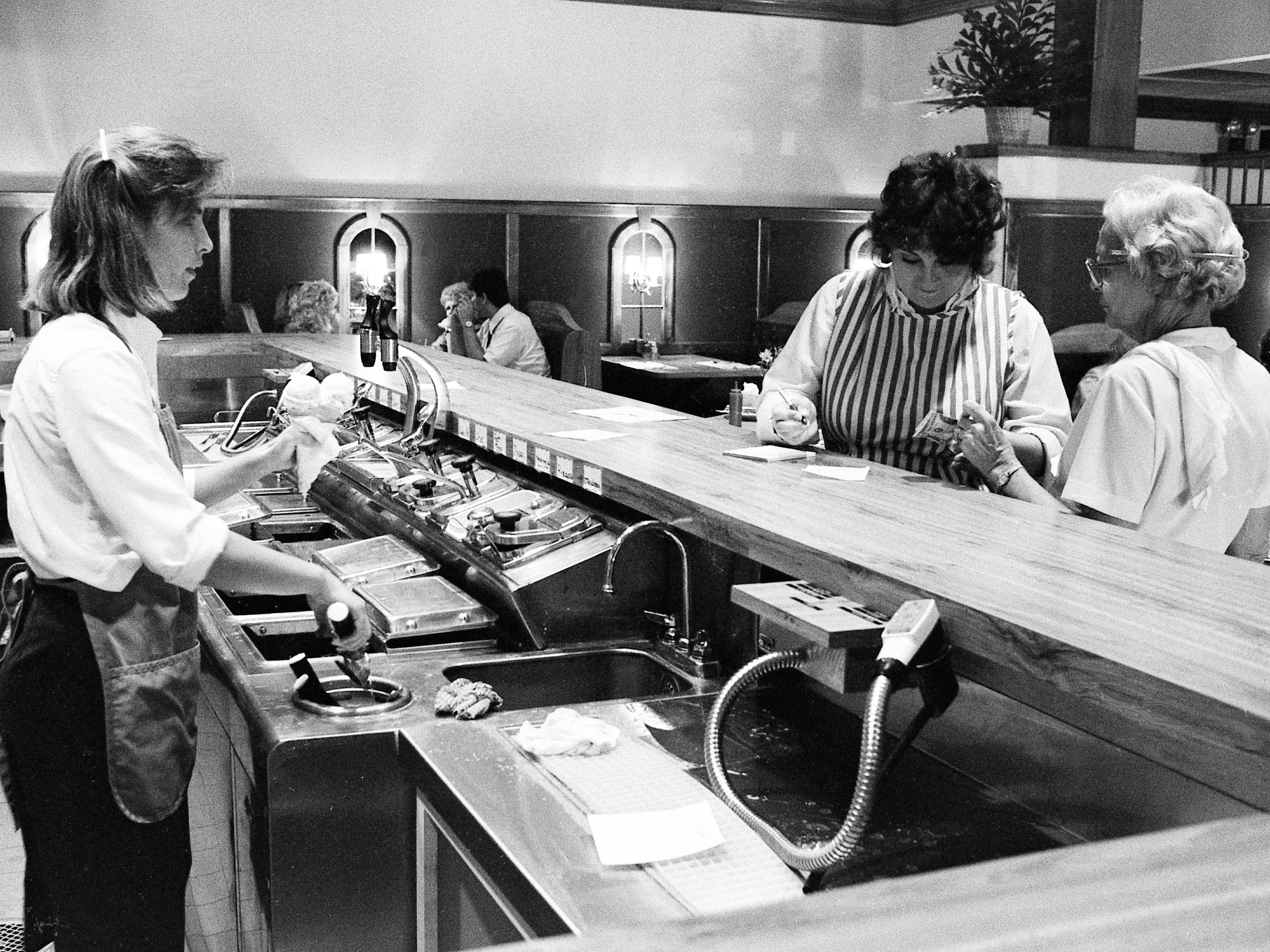 Courtney Dodge, left, is making desserts at the new Candyland Restaurant Sept. 4, 1985. The eatery in the Westgate Shopping Center is the first major expansion of the 65-year-old downtown Candyland.