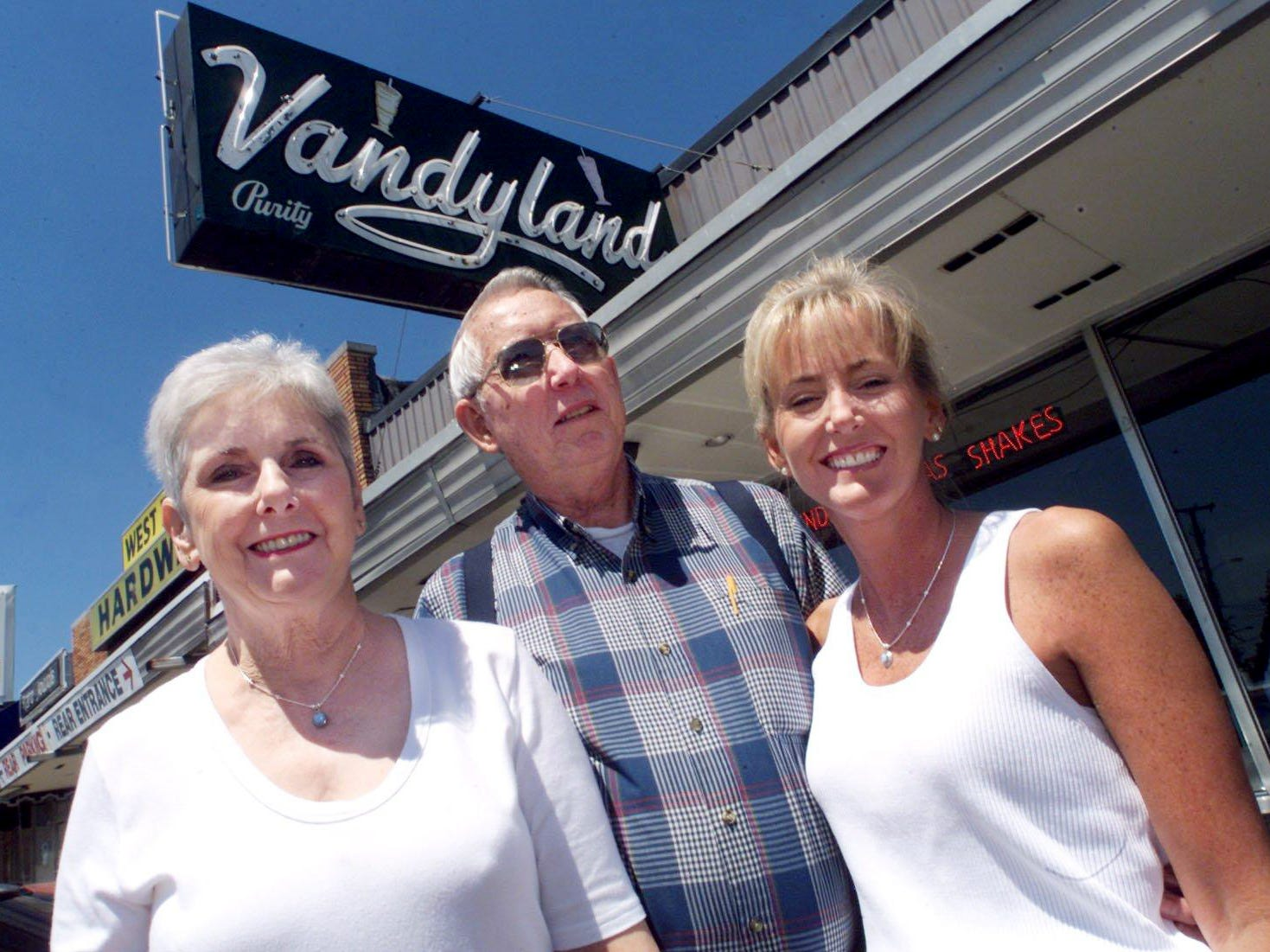 Vandyland owners Bea and Mitchell Givens and their daughter Malinda Abell stand outside the Vandyland store off West End May 14, 2002.