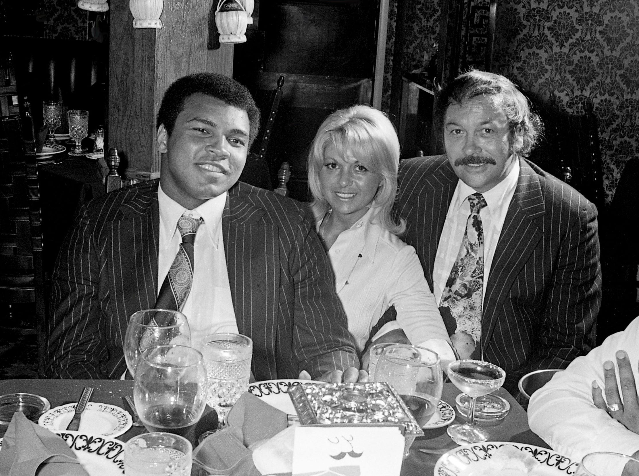World heavyweight boxing champion Muhammad Ali, left, talks with Mario Ferrari, right, owner of Mario's Restaurant, during dinner April 23, 1975. Ali was in Nashville for a taping of a special musical production featuring Fisk University.