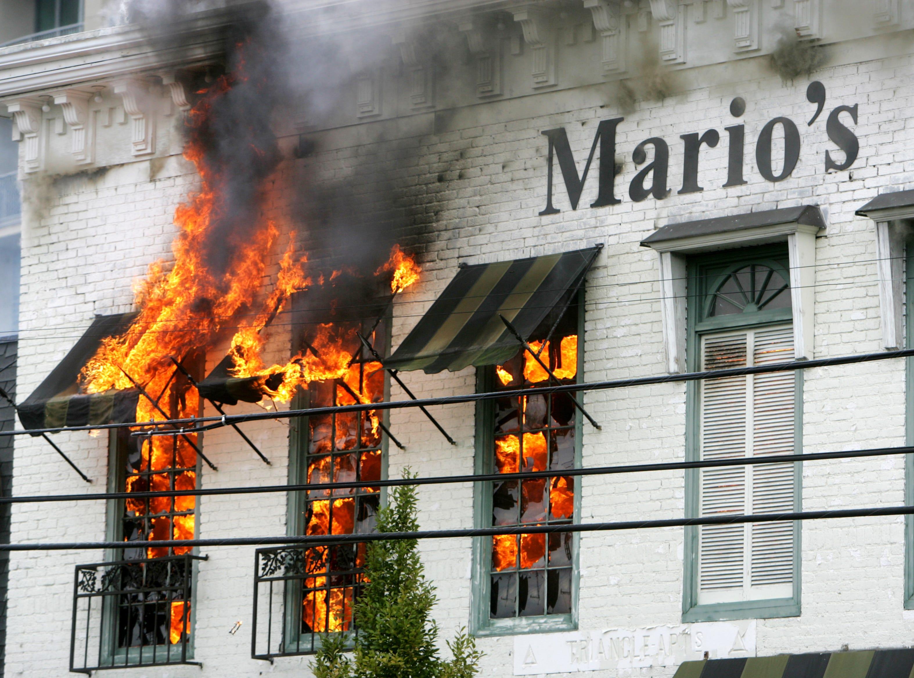 Fire comes through the windows at Mario's restaurant in Nashville Sept. 16, 2008.