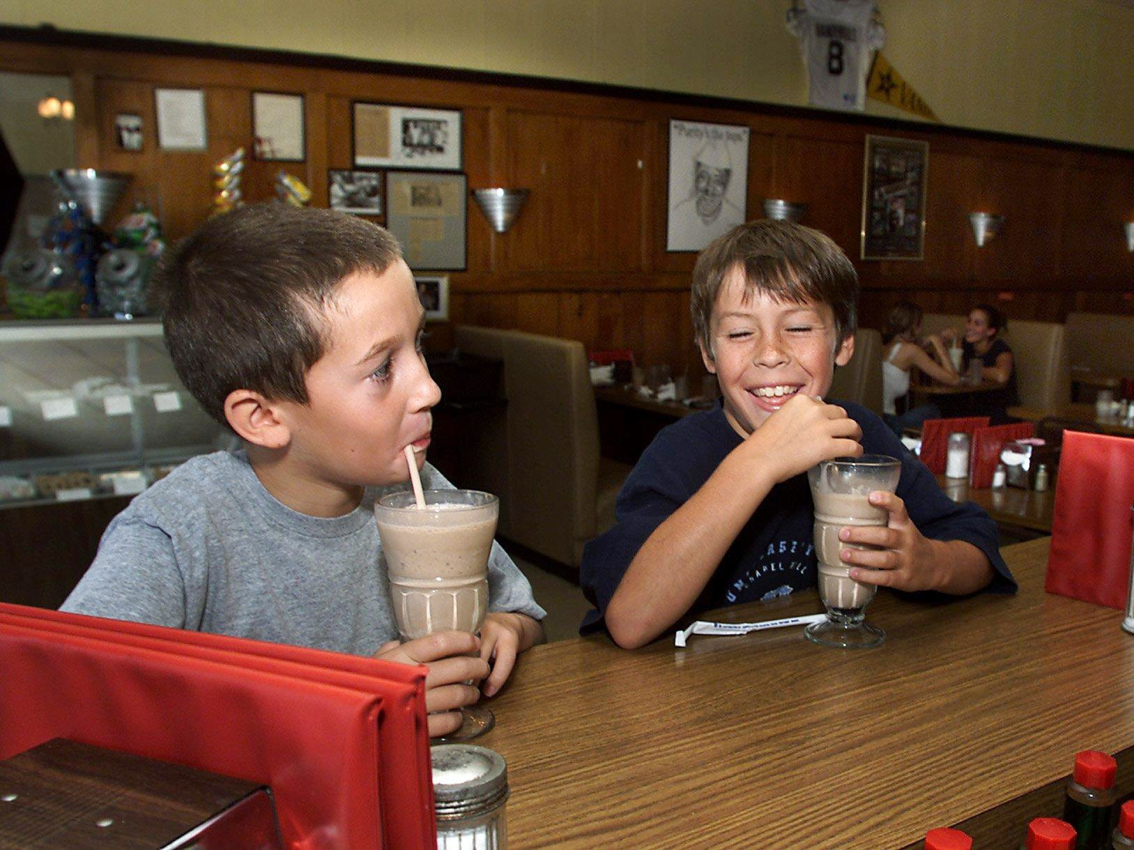 Michael Mayo, left, 10, and Will Holt, 9, students at Oak Hill School enjoy a big chocolate shake at Vandyland on West End Aug. 14, 2000. Both youngsters are regular customers.